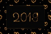 2019 and hearts light sings on black background