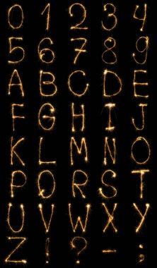 Close up view of light english alphabet and numbers on black background stock vector
