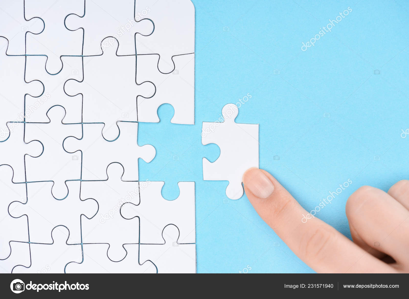 Partial View Woman Pointing White Puzzles Pieces Blue Background