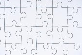 full frame of white puzzle pieces background
