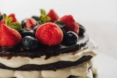 close-up view of delicious whoopie pie cake with fresh berries