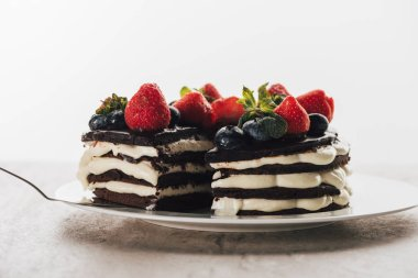 pieces of gourmet whoopie pie cake with fresh berries on white plate