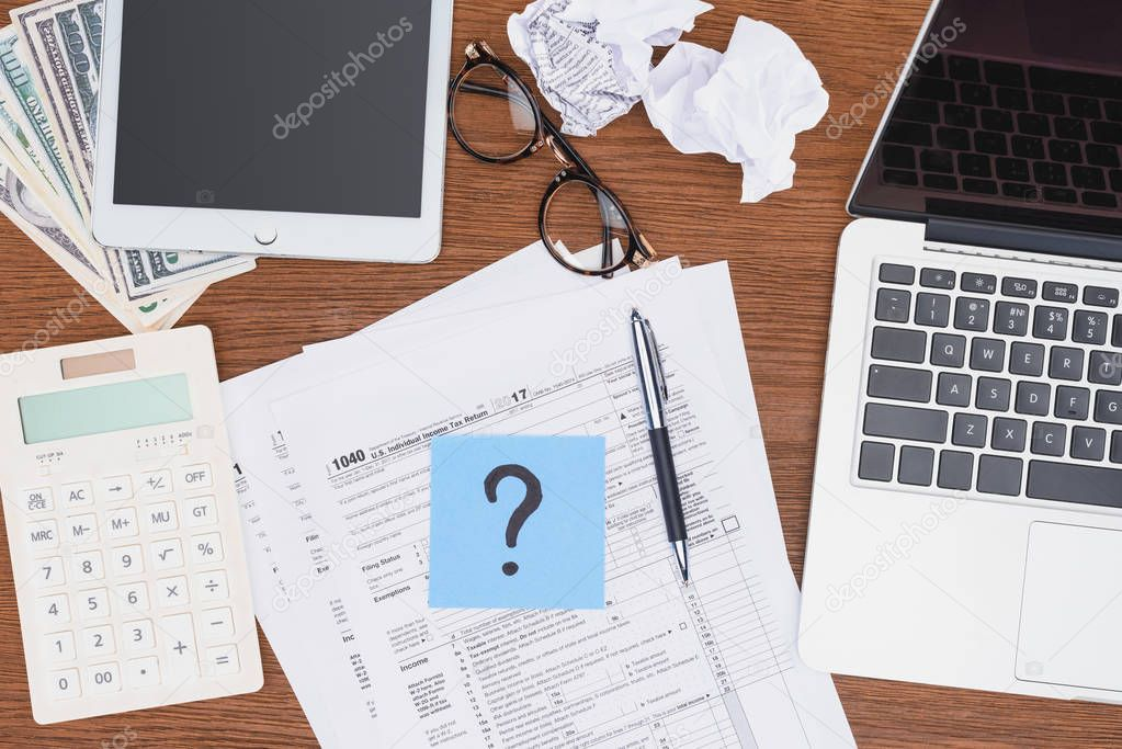 Top view of tax forms, digital devices and blue card with question mark on desk stock vector