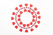 top view of circles made of red heart symbols isolated on white, st valentine day concept