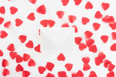 Top view of heart symbols and envelope isolated on white, st valentine day concept stock vector