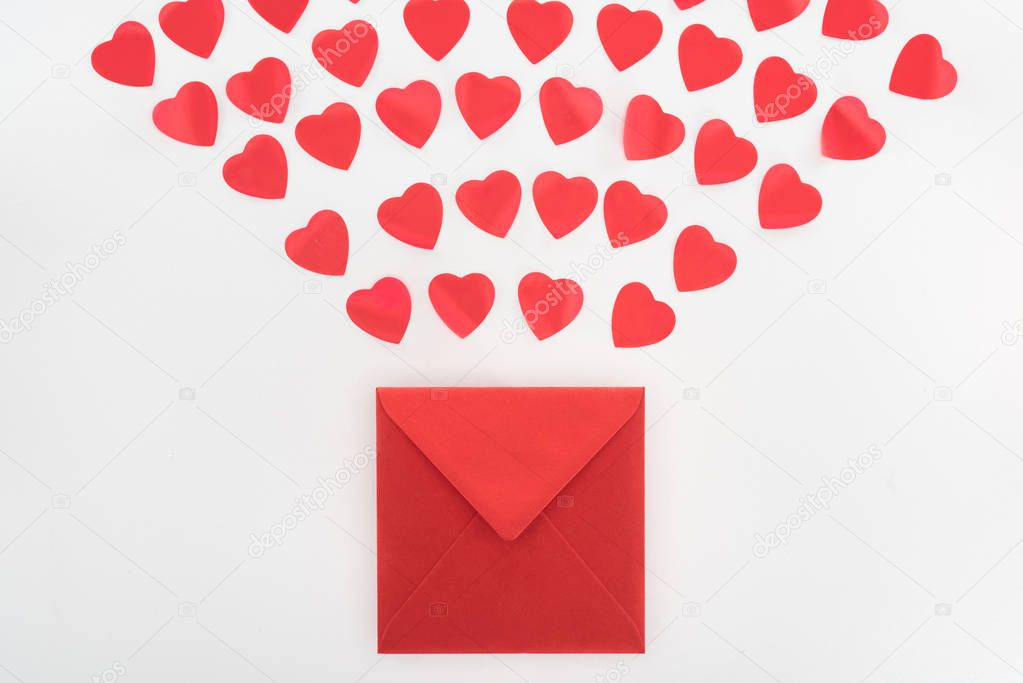 View from above of heart symbols and envelope isolated on white, st valentine day concept stock vector