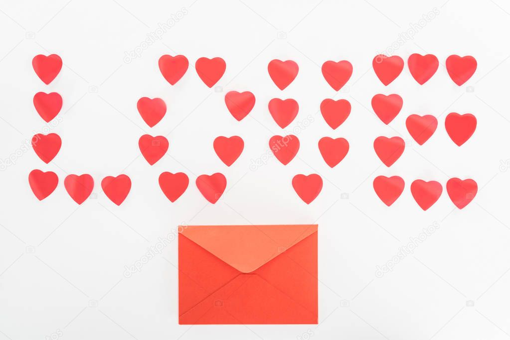 Top view of envelope and lettering love made of heart symbols isolated on white, st valentine day concept stock vector