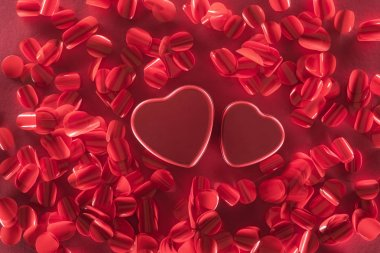 Close-up of red hearts and beautiful decorative petals, valentines day background stock vector