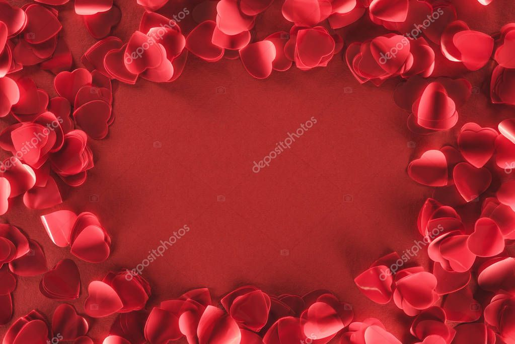 Top view of decorative heart shaped petals on red background, valentines day concept stock vector