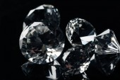 Fotografie close up of collection of pure shiny diamonds isolated on black