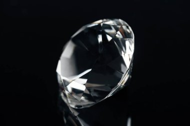 pure expensive diamond isolated on black