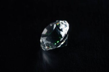 clear big diamond on black background