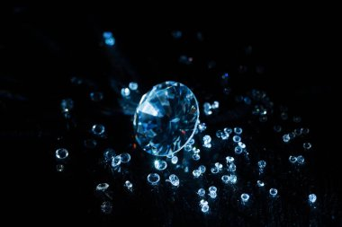 big and small transparent clear diamonds isolated on black