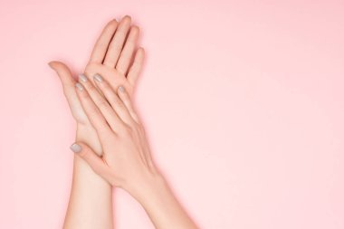 Cropped view of female hands isolated on pink with copy space stock vector