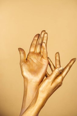 Partial view of female painted hands isolated on gold stock vector