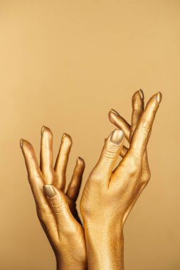Cropped view of female painted hands isolated on gold with copy space stock vector