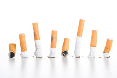 Studio shot of cigarette butts isolated on white, stop smoking concept