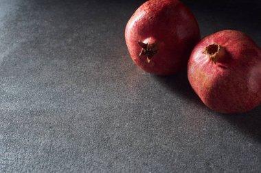 Studio shot of two fresh garnets on dark surface stock vector