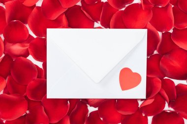 Top view of envelope with heart and red rose petals on background, st valentines day concept stock vector