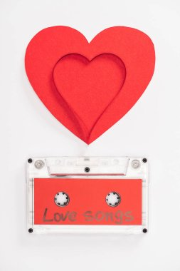 Top view of audio cassette with 'love songs' lettering and heart symbols isolated on white, st valentines day concept stock vector