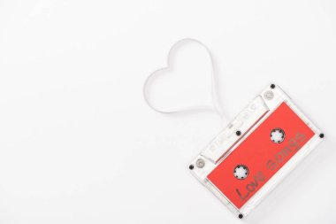 Top view of audio cassette with 'love songs' lettering and heart symbol isolated on white with copy space, st valentines day concept stock vector