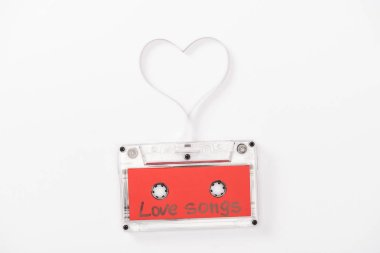 Top view of audio cassette with 'love songs' lettering and heart symbol isolated on white, st valentines day concept stock vector