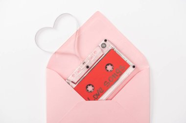 Top view of audio cassette with 'love songs' lettering and heart symbol in envelope isolated on white, st valentines day concept stock vector