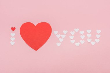 Background with 'i love you' lettering made of paper hearts isolated on pink, st valentines day concept stock vector