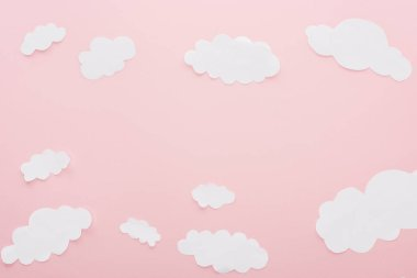 Top view of white paper clouds isolated on pink with copy space stock vector