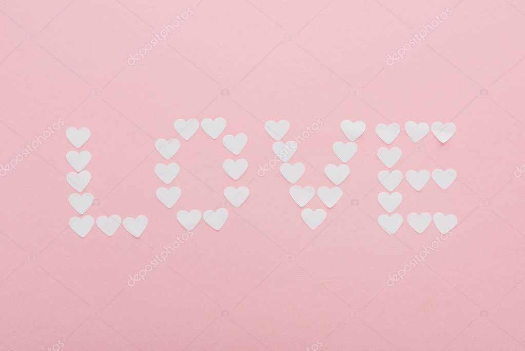 Top view of 'love' word made of paper hearts isolated on pink, st valentines day concept stock vector