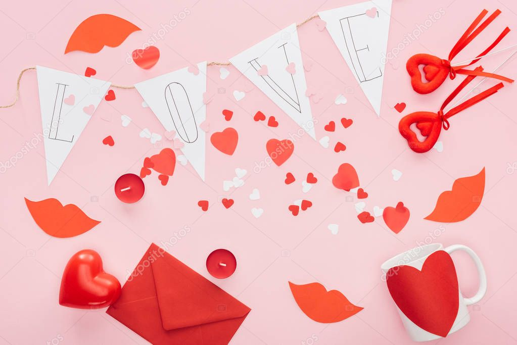 Top view of valentines decorations and paper garland with 'love' lettering isolated on pink, st valentines day concept stock vector