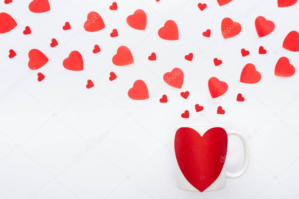 Top view of paper hearts and cup with heart shaped sticker isolated on white, st valentines day concept stock vector