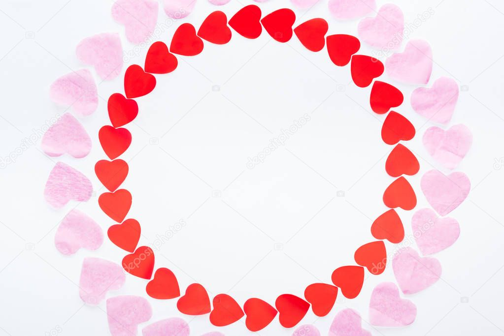 Top view of round frame made with red and pink paper hearts isolated on white, st valentines day concept stock vector