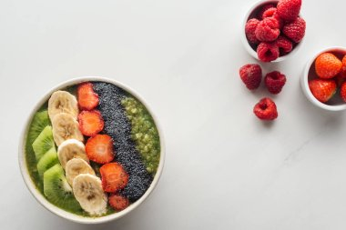 top view of smoothie bowl with fresh fruits on white background