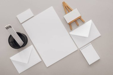 Flat lay with blank cards and stationery on grey background stock vector