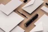 Fotografie Envelopes, pen, paper clip, case and sheets of paper with copy space