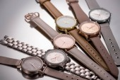 selective focus of elegant wristwatches lying on grey background