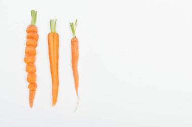 top view of sliced carrot, cut and whole carrots isolated on white with copy space