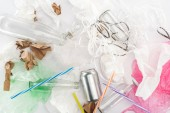 Photo Top view of can, glass bottles, paper strips, paper, bulb, plastic tubes and plastic bags