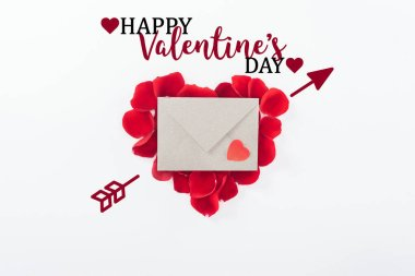 Top view of envelope and heart made of red rose petals isolated on white with