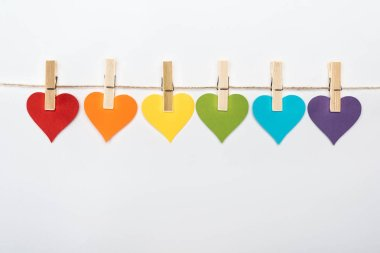 Rainbow multicolored paper hearts on rope isolated on white, lgbt concept stock vector