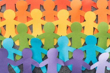 colorful paper cut figures of lgbt pride on grey background, lgbt concept