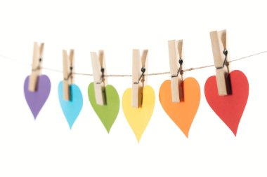 Selective focus of rainbow multicolored paper hearts on rope isolated on white, lgbt concept stock vector