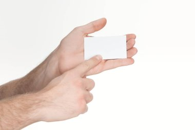 Cropped view of man holding blank and empty card isolated on white stock vector