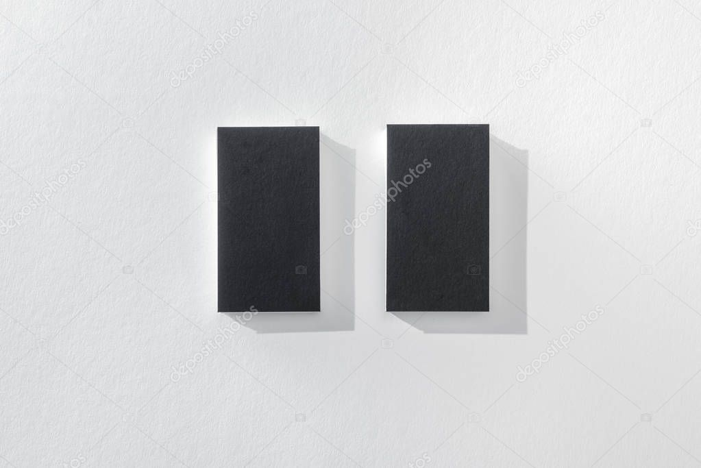 Top view of black empty cards on white background with copy space stock vector