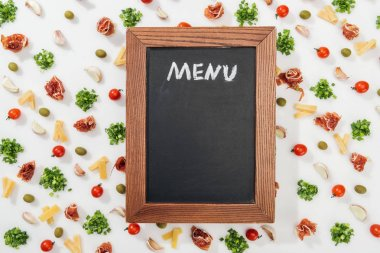 Chalk board with menu lettering among olives, garlic cloves, prosciutto, greenery, cut cheese and cherry tomatoes stock vector