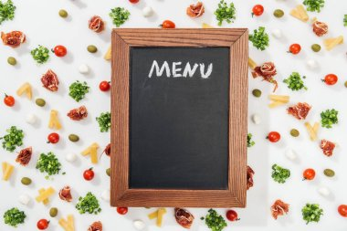 Chalk board with menu lettering among olives, prosciutto, greenery, mozzarella, cut cheese and cherry tomatoes stock vector