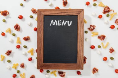 Chalk board with menu lettering among olives, prosciutto, mozzarella, cut cheese and cherry tomatoes stock vector