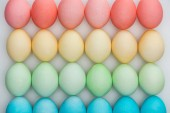 Fotografie top view of colorful pastel easter eggs on grey