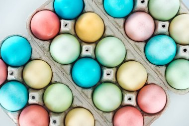 top view of colorful easter eggs in paper containers